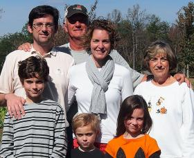 Katie Sweet (center) and her family.