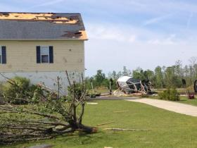 An EF-3 Tornado damaged homes, uprooted trees and tossed aside boats in the town of Chocowinity on Friday night