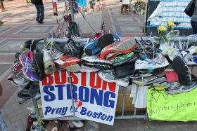 Runners left shoes to memorialize the dead and injured in Boston.