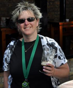 Dottie Adams, with her medal and a post-race beverage at Brazen Head Pub in Dublin.