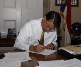 The Governor tweeted this photo today. The tweet said 'It's that time again...time to sign some bills! #ncpol #ncgov '