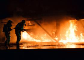 Firefighters use hose to tame large fire