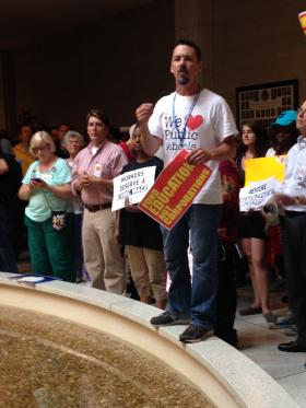 Protesters gathered outside the Senate chamber on Monday to demonstrate against policies they say are regressive.