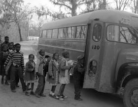 Photo of African American students getting on a school bus in Grimesland, North Carolina in the 1950s