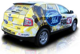A picture of a car wrapped in Fox News and American Idol ads.