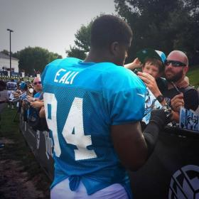 Rookie defensive end Kony Ealy signing autographs for fans after practice.