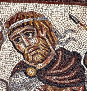 This photo shows the head a figure that might be Alexander the Great. It is from a mosaic scene that is the first non-Biblical mosaic every uncovered in an Israeli synagogue.