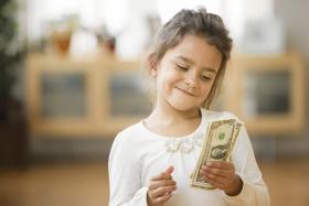 Young girl contemplates money