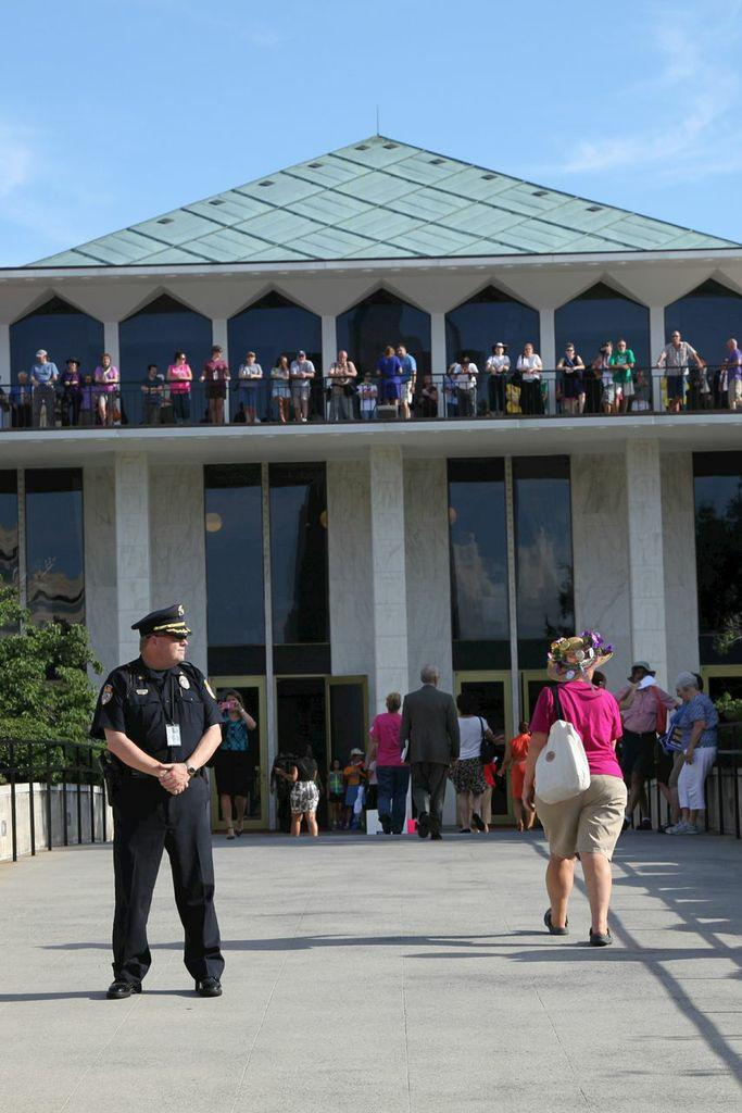 Police stand outside the capitol during a Moral Mondays protest.