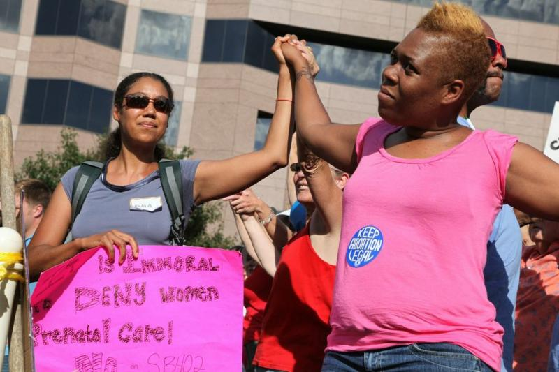 Protesters take a stand for abortion and women's rights at a Moral Mondays protest.