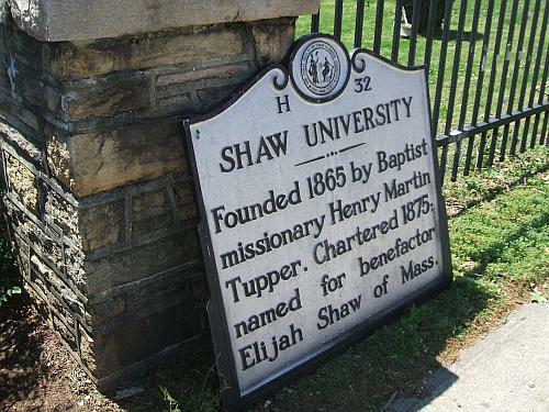 Shaw University's historic marker propped on the ground after storm.