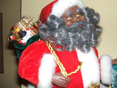 Black Santa figurine sits on a mantel at the Matory Home in Durham, NC.