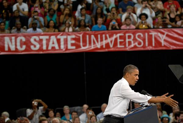 President Obama rallies the crowd at Reynolds Coliseum