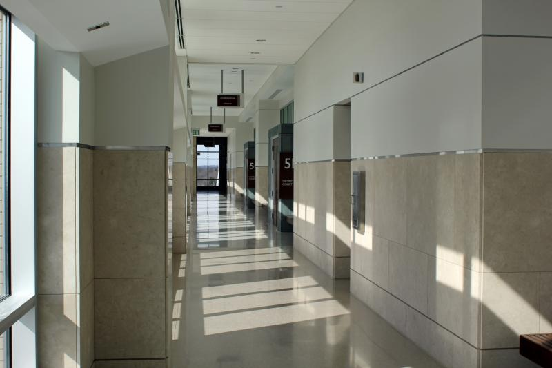 A wall of windows allows for natural light in the courtrooms.