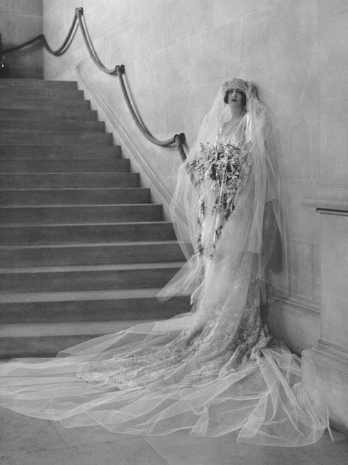 Cornelia Vanderbilt's formal wedding portrait, 1924. She posed at the foot of the Grand Staircase in Bilmore House.