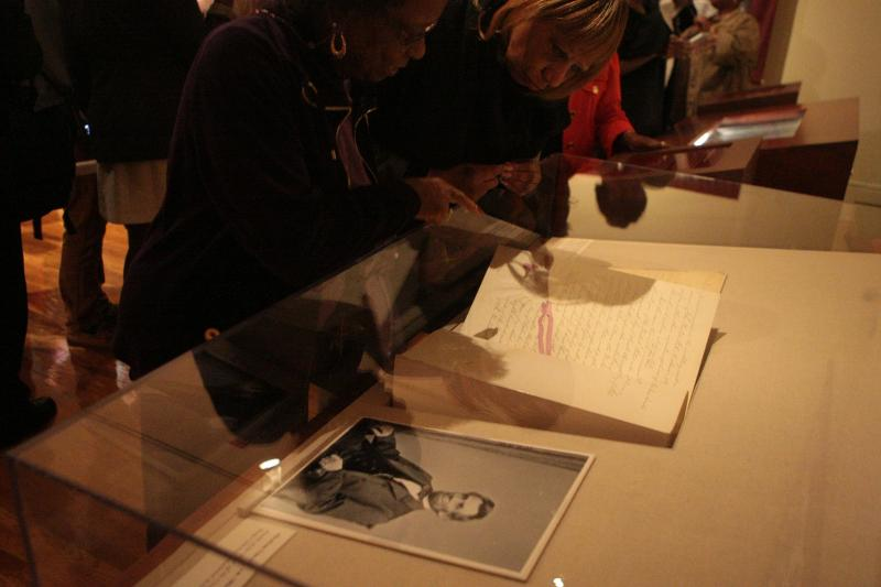 Visitors at the Schomburg Center for Research in Black Culture view the historic document on loan from the National Archives, Sept. 21, 2012