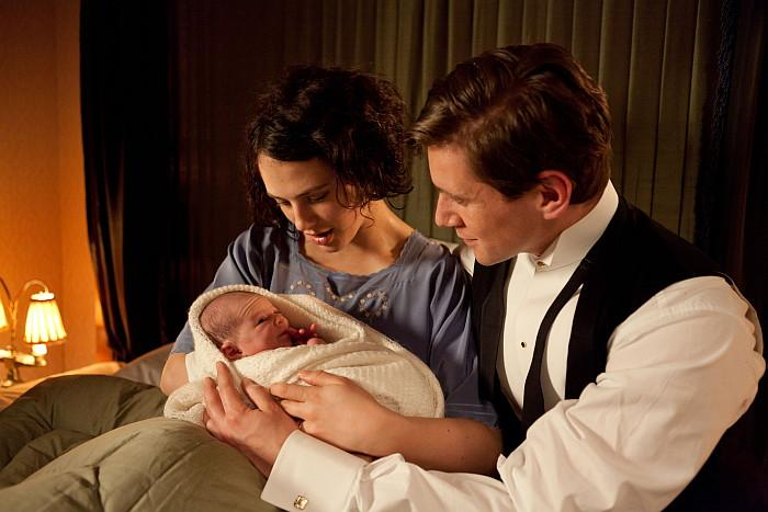 Sybil Crawley,  Tom Branson, and their newborn daughter