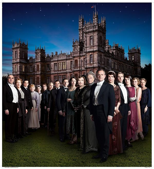 Downton Abbey cast in front of Highclere Castle