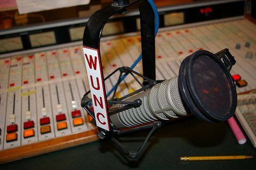Picture of WUNC microphone and control room board