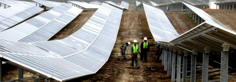 Construction workers monitor the a solar farm in Fuquay Varina