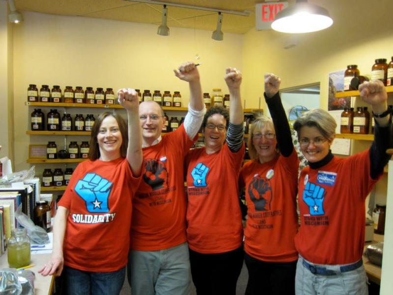 Leaders of a cooperative featured in Shift Change raise their fists in solidarity
