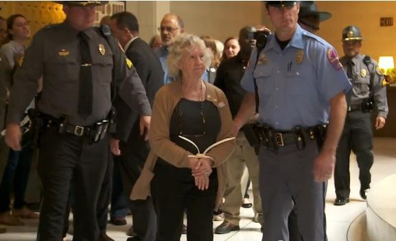 A woman is arrested at the state capitol as a part of a Moral Mondays protest.