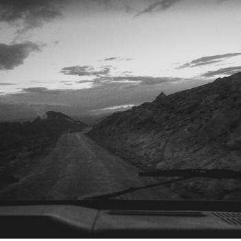 Black and white image of a desert road