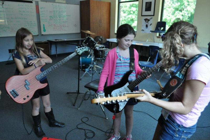 Girls practice their instruments and also compose an original song.