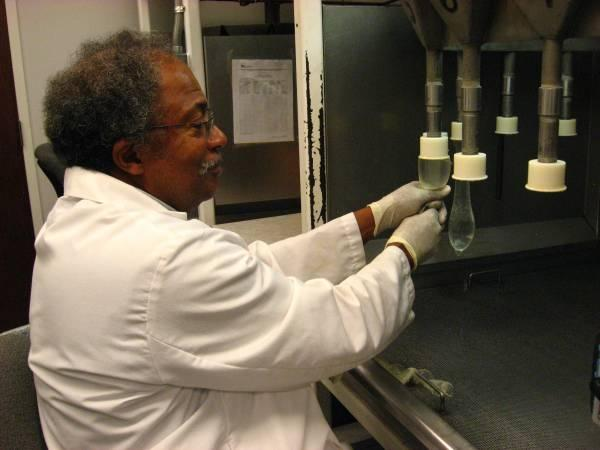 FHI worker Joseph Galloway detects holes in condoms by filling them with water.
