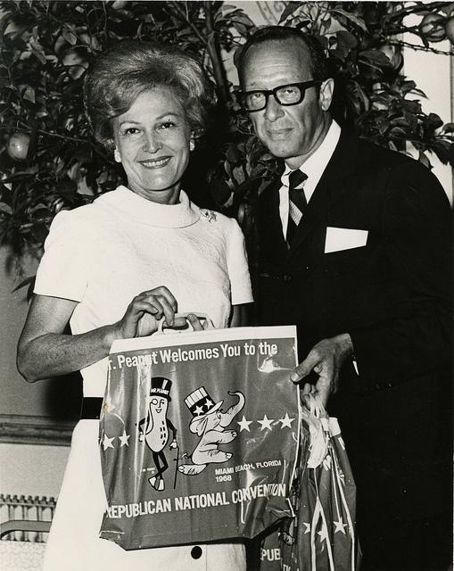Pat Nixon and Roy Fishman, Director of Publicity for Standard Brands, pose with Mr. Peanut bag at the 1968 Republican National Convention.
