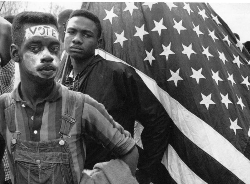 Photo: Two teens in 1962 with an American flag