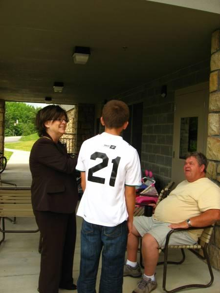Dr Phyllis Crain and one of the residence counselors talks with a boy outside a cottage at Crossnore.