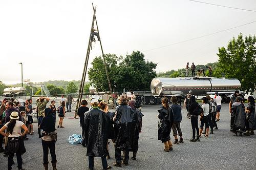 One of two wooden tripods built by protesters in front of an entrance to a chemical plant in Morganton, NC. A person was perched at the top of the contraption for several hours, preventing vehicles from entering or leaving the plant.