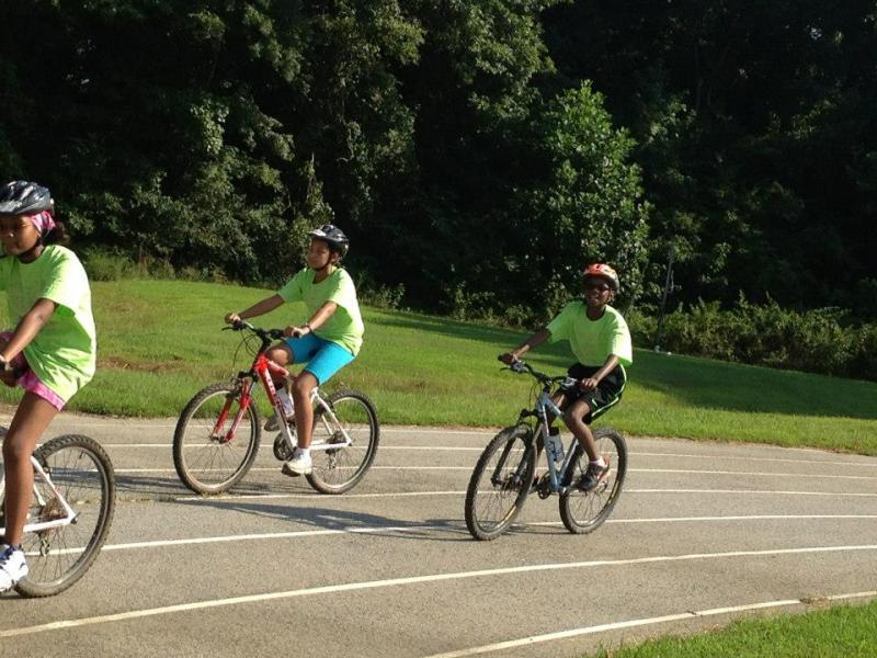 Two students at Durham's School for Creative Studies try out for the new cycling team.