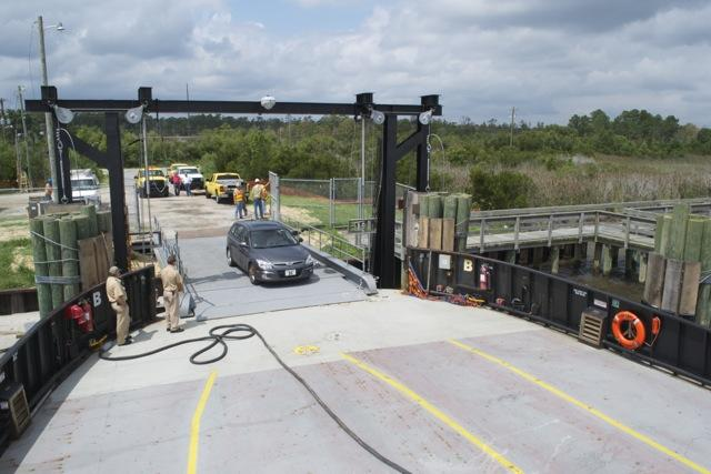 Car loads onto the M/V Stanford White ferry  at the Stumpy Point Ferry Terminal Thursday. DOT workers and contractors successfully tested new ramps at both Stumpy Point and Rodanthe, which serves as an emergency ferry route after major storms cut road acc