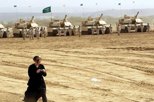 Photo: Kelly McEvers in front of four tanks