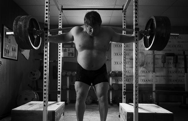 Greg Stott practices powerlifts in his training room in Sanford.