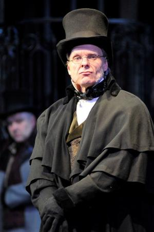 Michael Huie as Scrooge in the North Carolina Shakespeare Festival's production of A Christmas Carol.