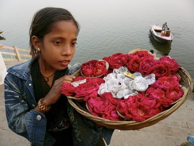 Photo: A girl by the Ganges River in the city of Varanasi