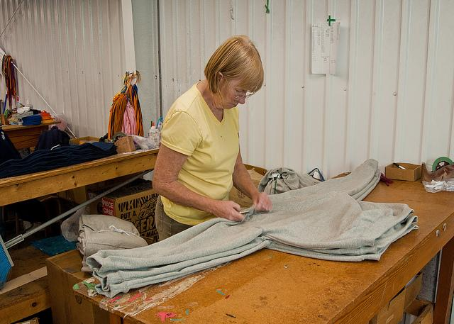 An employee performs quality control on clothing made at the Mortex textile mill in Wendell, North Carolina