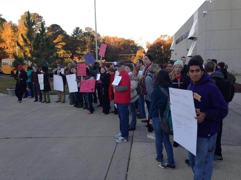 Teachers demonstrate Monday morning outside Riverside High School in Durham