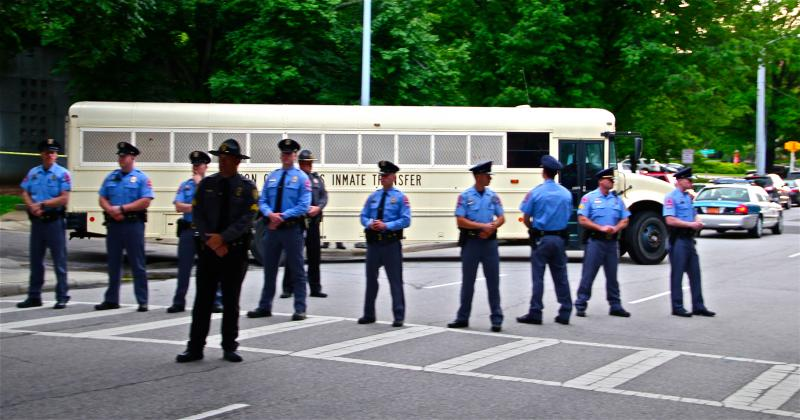 Dave Otto's photograph of police, waiting to transfer new inmates.