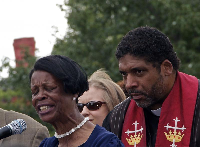 Dave Otto captured Senator Earline W. Parmon (left). William Barber listens.