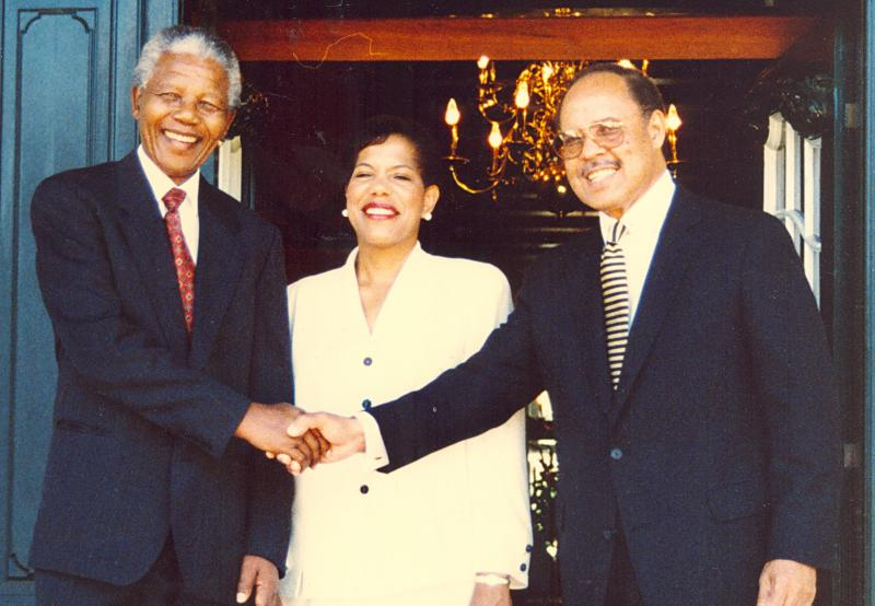 Mandela, Mary and james Joseph shaking hands