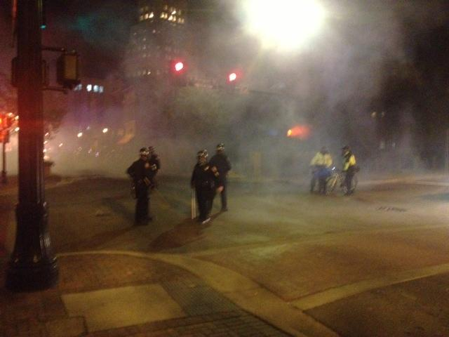 Durham Police in riot gear used tear gas to break up a rowdy crowd protesting the death of a local teen last night.