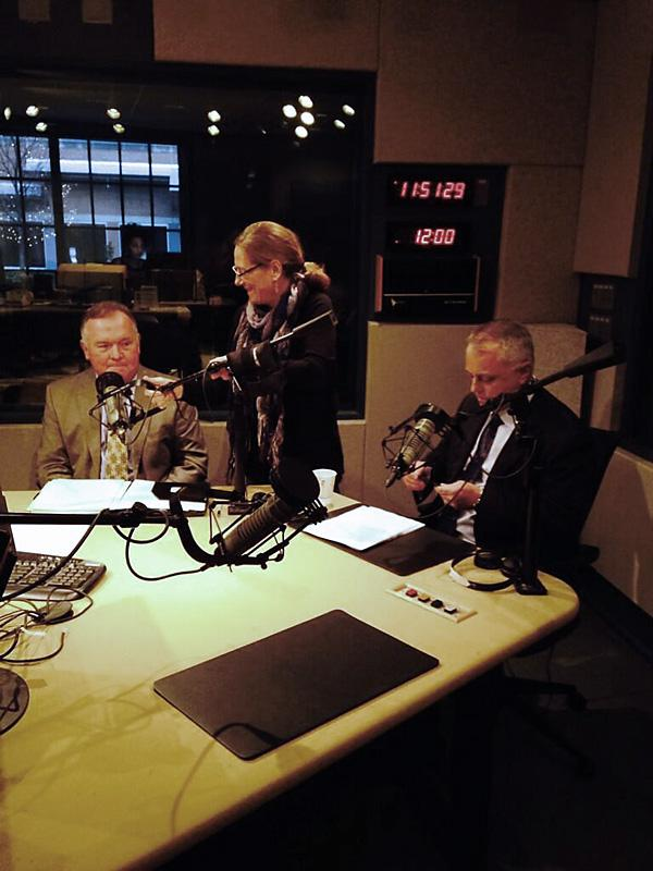 SELC's Derb Carter (left) and NC DOT's Tony Tata in the WUNC Durham Studios for The State of Things. Engineer Robin Copley adjusts the microphones.