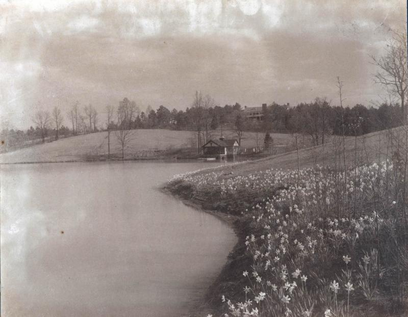 The Reynolds estate. Foreground: Lake Katharine. The estate is on the hill in the background. The smaller building in the foreground is the Boathouse