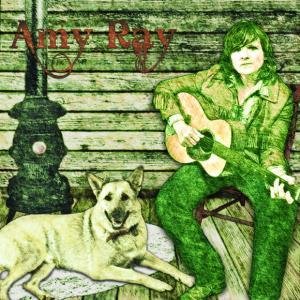 Amy Ray on porch with guitar