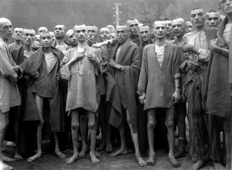 Prisoners at Ebensee Concentration Camp in 1945. Many of those who survived camps like these now speak out as a part of Speaker's Bureaus around the country.