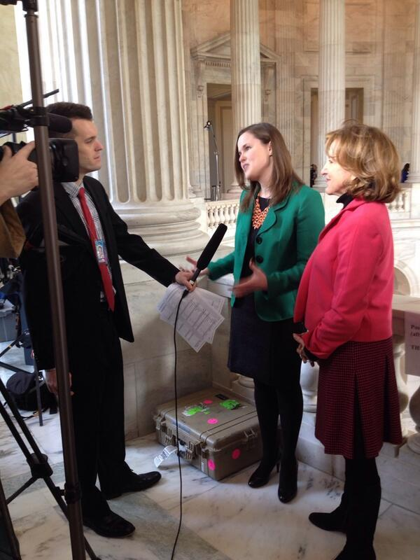 NC Teacher of the Year Karyn Dickerson, being interviewed at the State of the Union, with Senator Kay Hagan (right).